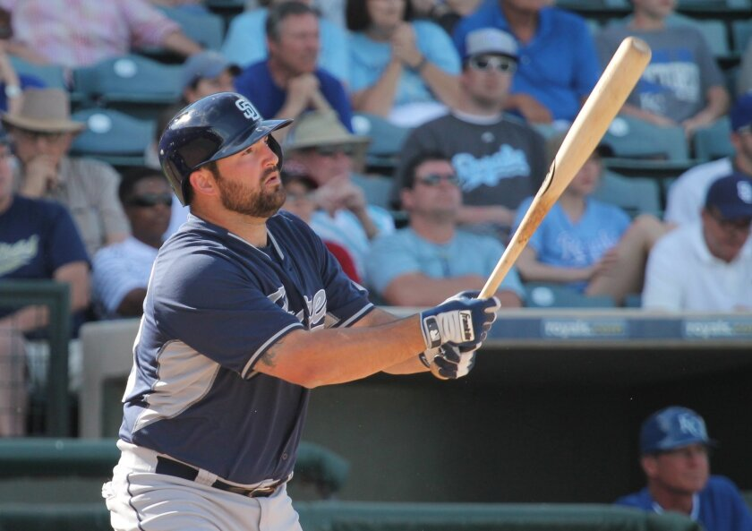 Padres infielder Cody Decker looks up as he hits a two-run home run against the Kansas City Royals.
