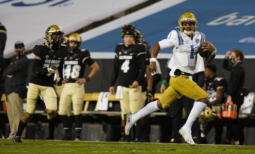 UCLA quarterback Dorian Thompson-Robinson runs with the football against Colorado on Nov. 7 in Boulder.