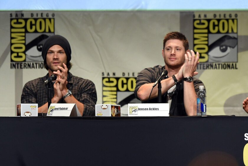 """Actors Jared Padalecki (L) and Jensen Ackles speak onstage at the """"Supernatural"""" panel during Comic-Con International 2015 at the San Diego Convention Center on July 12, 2015 in San Diego, California. (Photo by Kevin Winter/Getty Images)"""