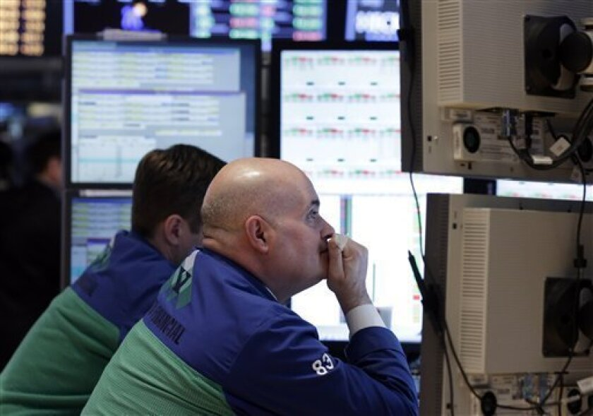 Specialist Anthony Confusione, right, works at his post on the floor of the New York Stock Exchange Thursday, Feb. 14, 2013. Renewed worries about Europe overshadowed an encouraging U.S. jobs report, and stocks flipped between slight gains and losses on Thursday. (AP Photo/Richard Drew)