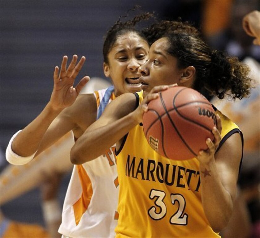 Marquette guard Angel Robinson (32) is guarded by Tennessee's Meighan Simmons during the first half of a second-round game in the NCAA college basketball tournament on Monday, March 21, 2011, in Knoxville, Tenn. (AP Photo/Mark Humphrey)