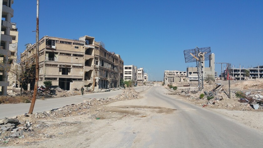 An entrance to Layramoun, an industrial zone near Aleppo, Syria, shows devastation as a result of the Syrian civil war.