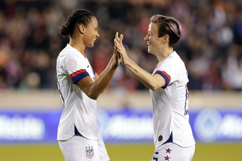 U.S. forwards Lynn Williams and Megan Rapinoe, right, celebrate Williams' goal in a CONCACAF Olympic qualifying match Jan. 31, 2020.