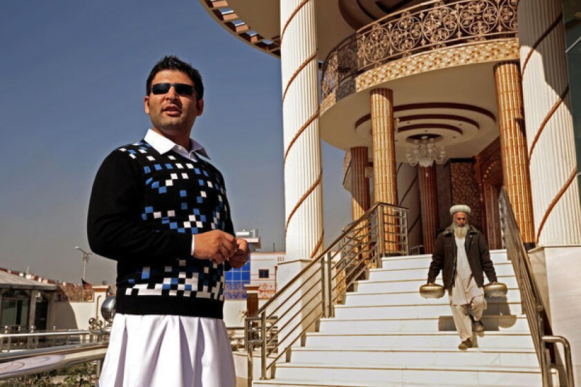 Entrepreneur Mohammed Ibrahim Caravan, 28, helped build Saleem Caravan City, the glittering gated community of 300 homes protected by high-tech security and armed guards in Kabul, the Afghan capital.