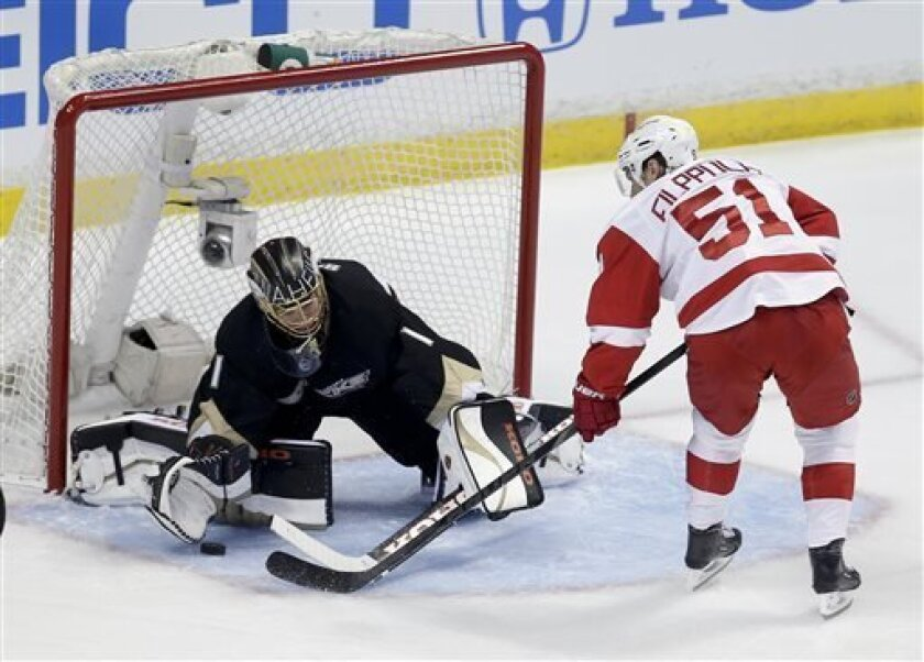 Anaheim Ducks goalie Jonas Hiller, right, blocks a shot by Detroit Red Wings center Valtteri Filppula during the first period in Game 1 of their first-round NHL hockey Stanley Cup playoff series in Anaheim, Calif., Tuesday, April 30, 2013. (AP Photo/Chris Carlson)