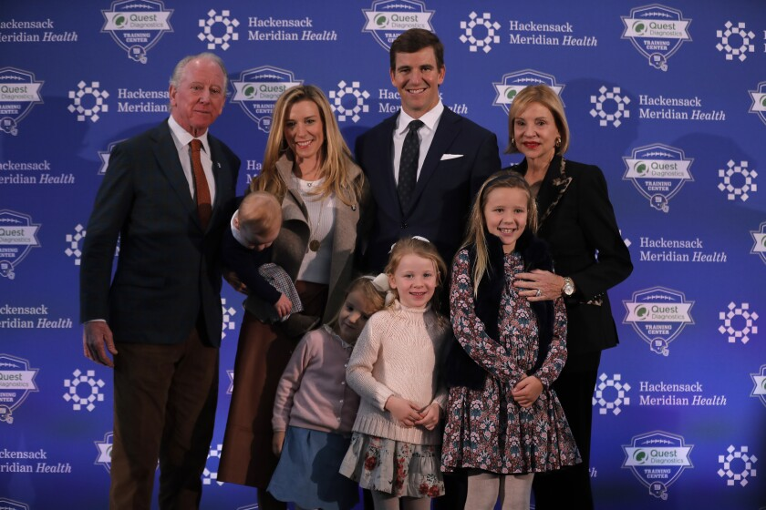Eli Manning, center, poses with with his family and parents after announcing his retirement from the NFL in January.