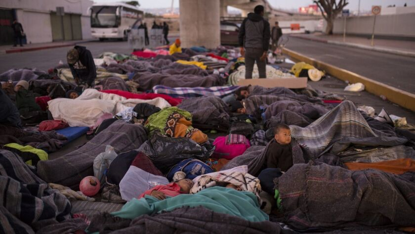 Migrants sleep under a bridge at the Chaparral border crossing in Tijuana, where the mayor has declared a humanitarian crisis.