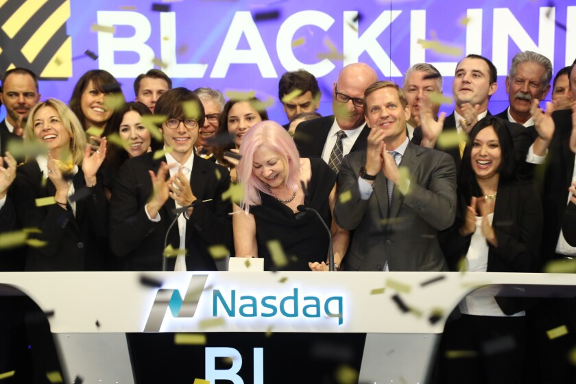 BlackLine Inc. Chief Executive Therese Tucker, center, rings the opening bell at Nasdaq on Friday before the Woodland Hills company debuted on the stock exchange.