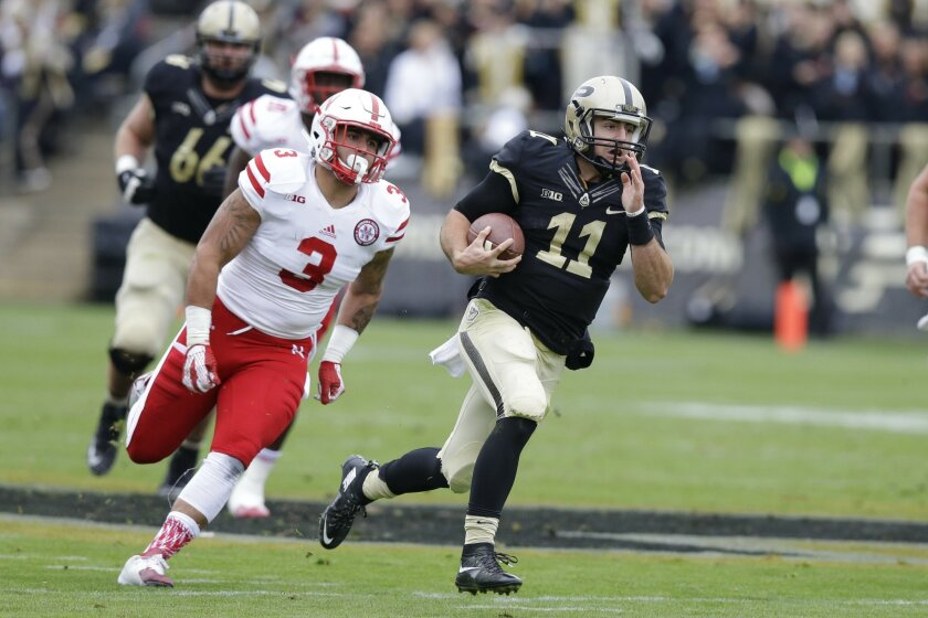 Purdue quarterback David Blough (11) runs for a touchdown in front of Nebraska linebacker Marcus Newby (3) during the first half of an NCAA college football game in West Lafayette, Ind., Saturday, Oct. 31, 2015. (AP Photo/Michael Conroy)