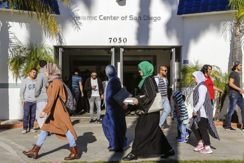 Muslims leave after prayers at the Islamic Center of San Diego. A hate crime on SDSU's campus and drawings of swastikas at UCSD have left the community on edge.