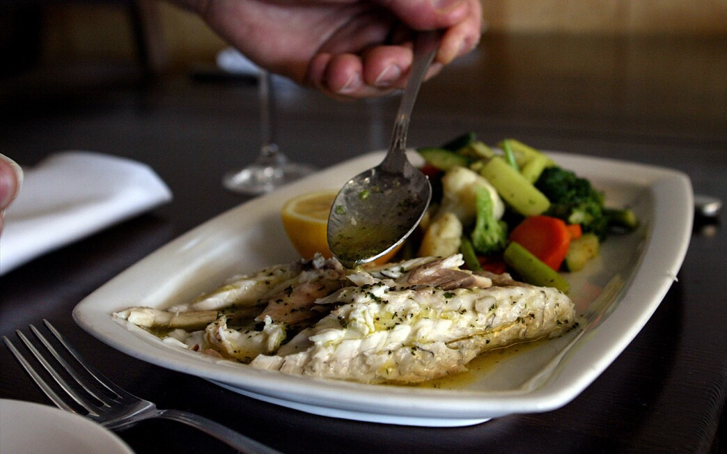 Whole fish roasted in sea salt with aromatic herbs