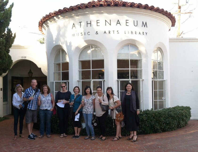 San Diego Tourism Authority public relations manager Robert Arends leads a media tour of key La Jolla businesses and destinations in November 2014 including the Athenaeum Music & Arts Library.