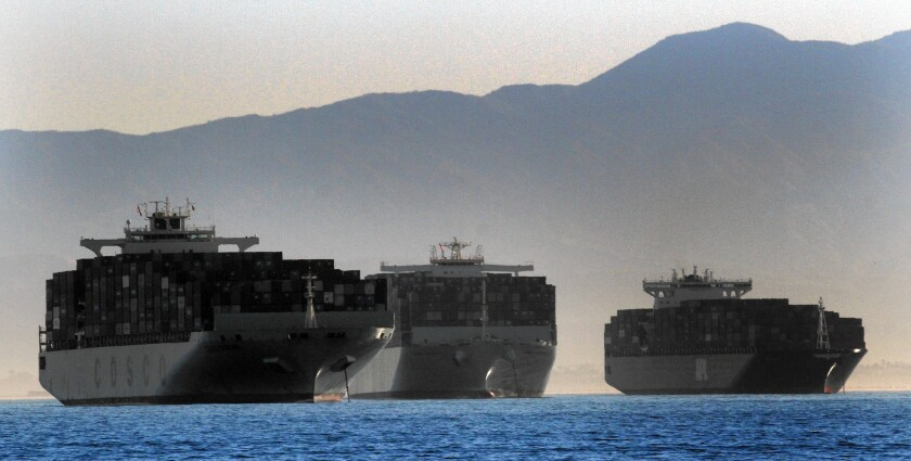 Economists and trade experts say a potential shutdown of 29 West Coast ports would have very little effect on the broader U.S. economy. Above, three container ships wait to dock this week at the ports in Long Beach and Los Angeles.
