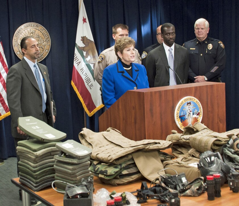Items seized in the sting are displayed.
