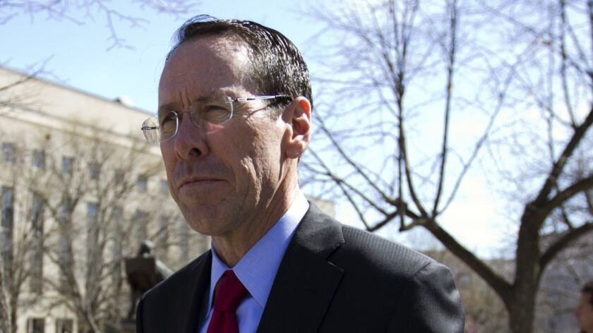 FILE- In this March 22, 2018, file photo, AT&T CEO Randall Stephenson leaves the federal courthouse