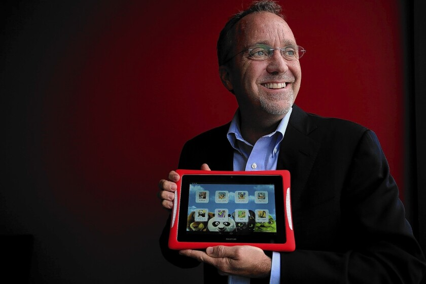 "Jim Mitchell, chief executive of Fuhu, shows off a DreamTab tablet, which his company built with DreamWorks Animation. The device's wide retail launch is set for June, shortly before DreamWorks Animation's film ""How to Train Your Dragon 2"" opens in theaters."