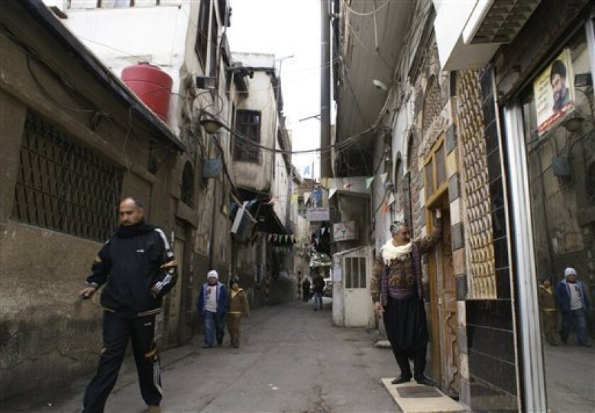 People walk in the alleys of the old city in Damascus, Syria, Thursday, Dec. 25, 2008. Development spurred by a shift toward a free market economy is threatening the old quarter of Damascus as aggressive investors flush with cash have pushed property prices so high that more and more homeowners are selling their homes and moving out. (AP Photo/Ola al Rifai) NO IONLN **