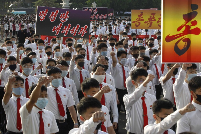North Korean students march June 8 in Pyongyang to denounce South Korean authorities.