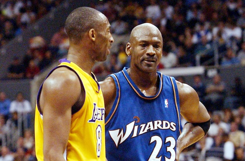 Kobe Bryant, left, and Michael Jordan talk during a break in action between the Lakers and Washington Wizards