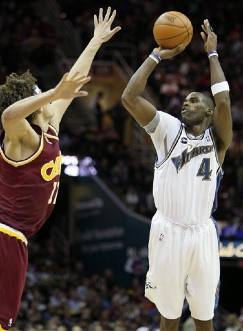 Washington Wizards' Antawn Jamison (4) shoots a three-point shot over Cleveland Cavaliers' Anderson Varejao, from Brazil, in the third quarter of an NBA basketball game Wednesday, Jan. 6, 2010, in Cleveland. Jamison scored 26 points in a 121-98 loss to Cleveland. (AP Photo/Mark Duncan)
