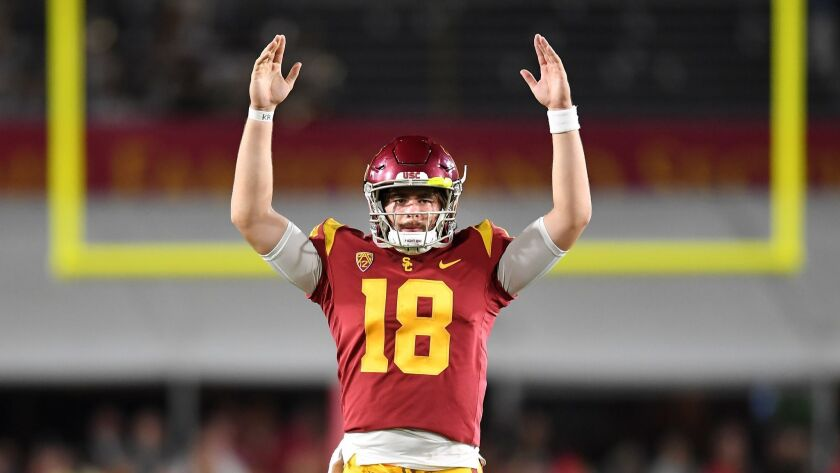 USC quarterback J.T. Daniels signals touchdown on a catch by Michael Pittman Jr.
