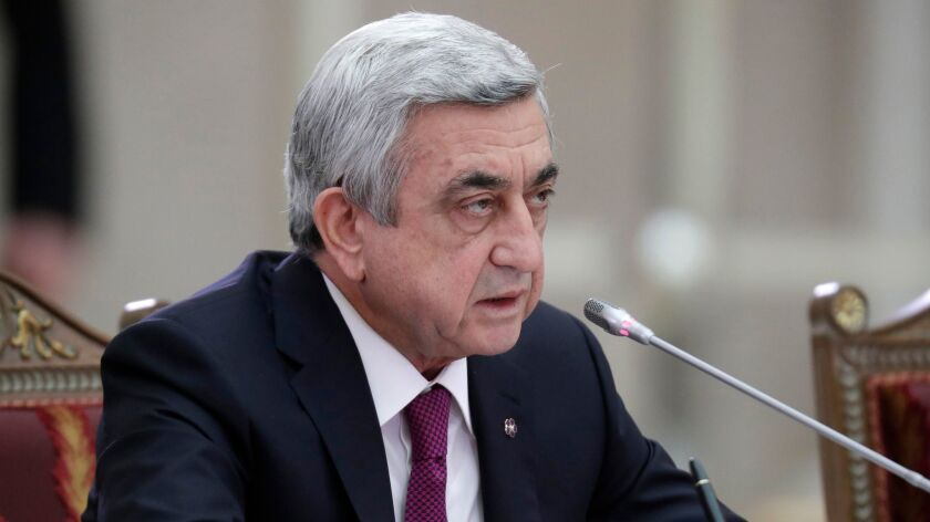 Armenian President Serzh Sargsyan attends the Supreme Eurasian Economic Council meeting in St. Petersburg, Russia on Dec. 26, 2016. Opposition demonstrators briefly seized the country's public radio to protest Sargsyan's shift into the prime minister's seat.