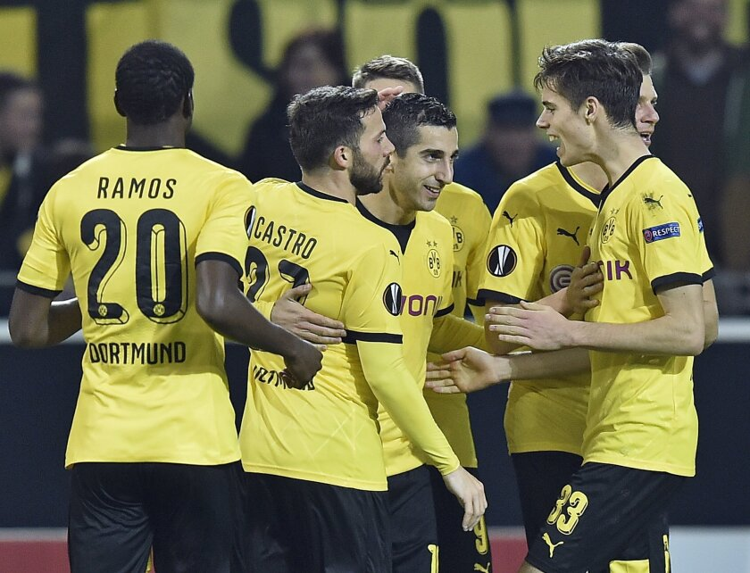 Dortmund's Henrikh Mkhitaryan, center,  is celebrated after scoring his side's 4th goal during the Europa League group C soccer match between Borussia Dortmund and Qabala FC in Dortmund, Germany, Thursday, Nov. 5, 2015. (AP Photo/Martin Meissner)