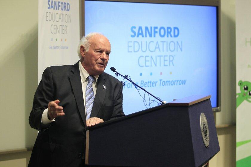 T. Denny Sanford speaks during the dedication of the new Sanford Education Center at National University.