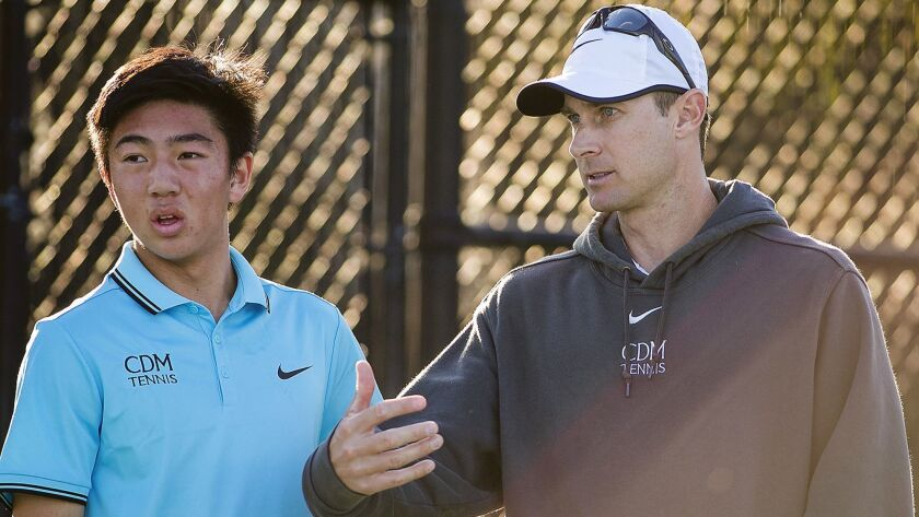 Corona del Mar's head coach talks with Kyle Pham during the Battle of the Bay on Thursday, March 2.