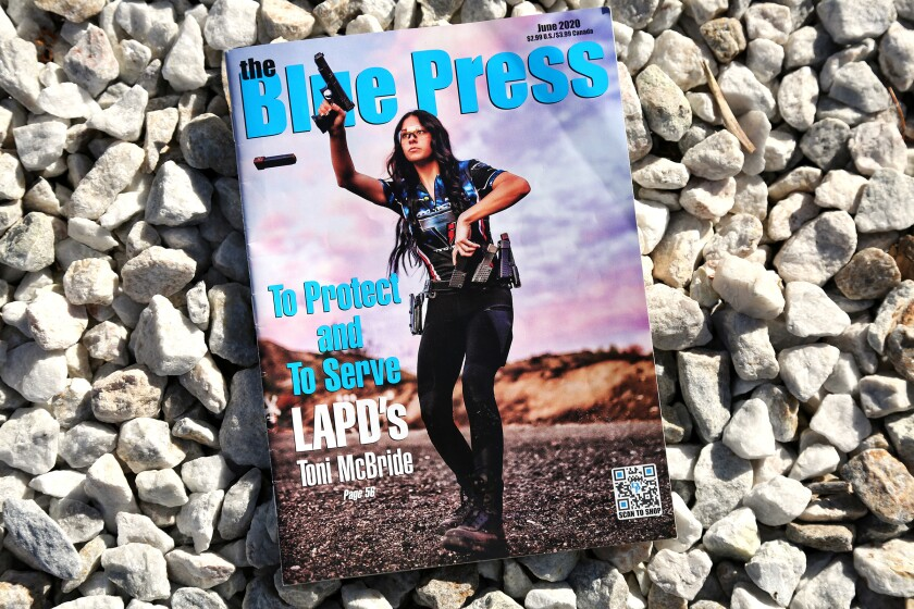 LAPD Officer Toni McBride raises a gun on the cover of June's Blue Press magazine, popular with police and firearms fans.
