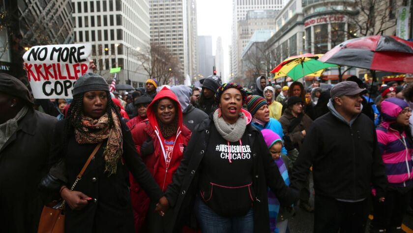 "People gather during a demonstration billed as a ""march for justice"" on Friday, Nov. 27, 2015, Chica"