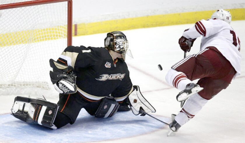Goaltender Jonas Hiller deflects a Shane Doan shot during a shootout during the Ducks' 3-2 shootout victory over the Phoenix Coyotes on Friday.