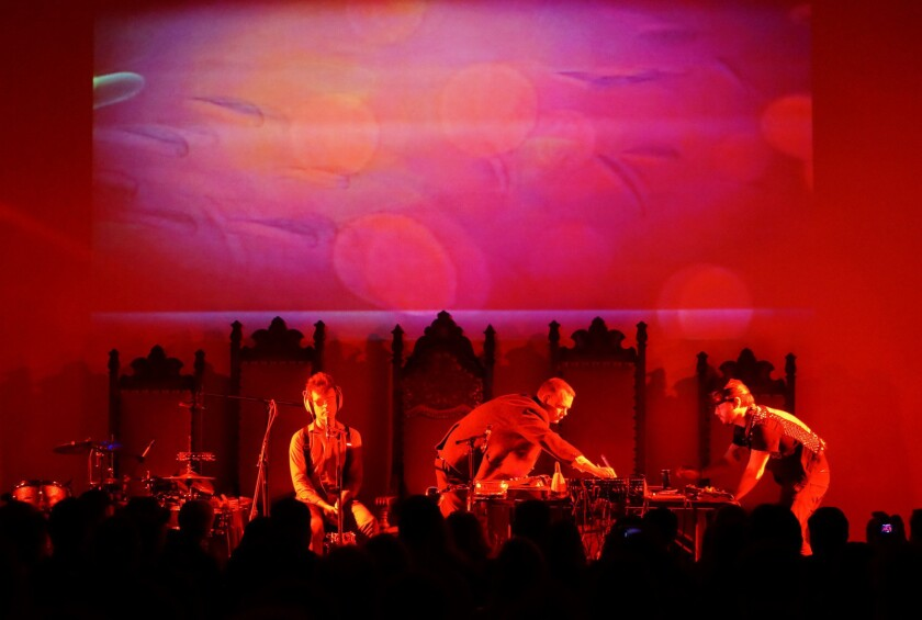 Owen Gardner (left) of Baltimore band Horse Lords sits in with Matmos members M.C. Schmidt (center) and Drew Daniel at the Masonic Hall at Hollywood Forever Cemetery on Monday.