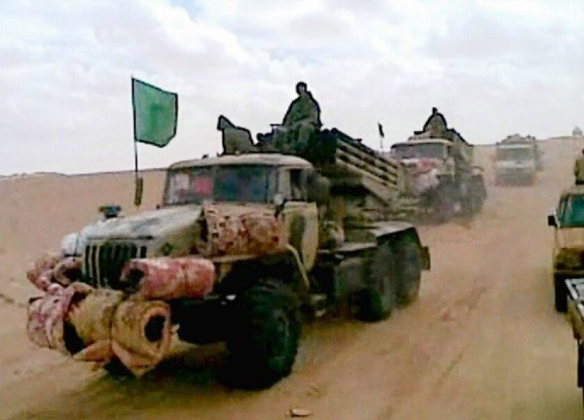 A cellphone image shows a militant convoy in the Malian desert. The French military intervention in Mali and a terrorist attack on a gas complex in neighboring Algeria have prompted debate in Washington over whether the threat warrants a military response.