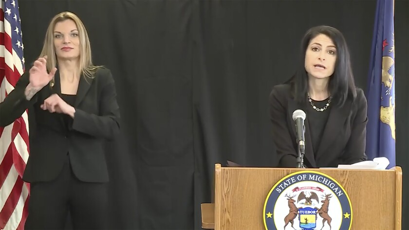 FILE - In this Jan. 14, 2021 file photo provided by the Michigan Office of the Attorney General, Dana Nessel, right, speaks in Lansing, Nessel has opened an investigation after a Republican-led state legislative panel said people are making baseless allegations about 2020 presidential election results in a northern Michigan county to raise money or publicity for their own ends.(Michigan Office of the Attorney General via AP)