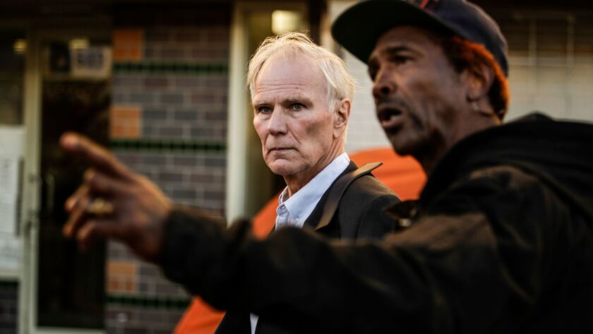 United Nations monitor Philip Alston tours last week with Los Angeles skid row activist General Dogon, right.