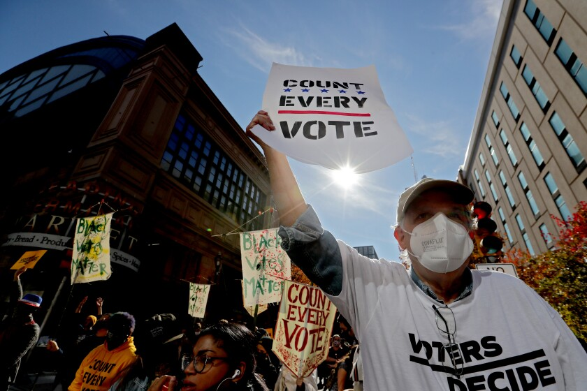 Anti-Trump protesters gather outside the Philadelphia Convention Center.