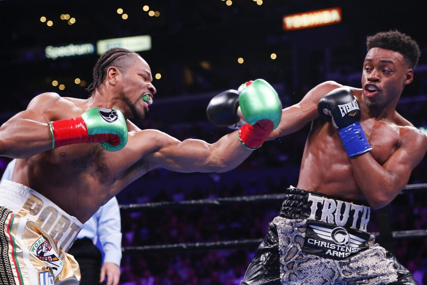 Errol Spence Jr., right, and Shawn Porter exchange punches during the WBC & IBF World Welterweight Championship boxing match on Saturday at Staples Center.