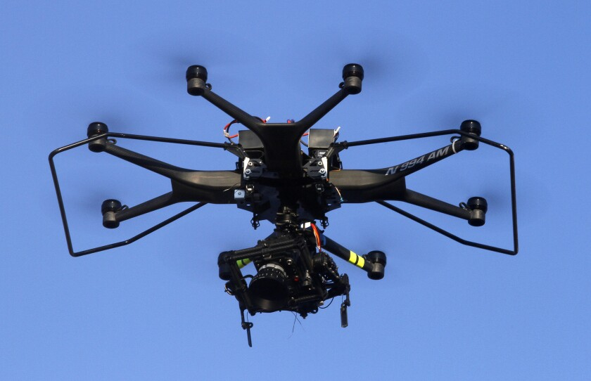 A drone with a camera is used to shoot scenes for a television show in Santa Clarita in September. The L.A. City Council approved an ordinance Wednesday that criminalizes violating FAA drone regulations.