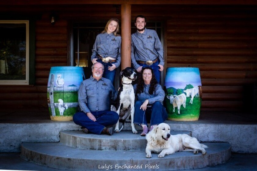 Sorbo family: clockwise from top left, Adelaide, Russell, Lori, Eli the Great Dane, Todd, with Sarafina the Great Pyrenees.