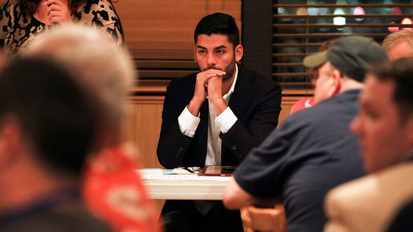 SANTEE, August 17, 2017 | Ammar Campa-Najjar, 28, a candidate for 50th congressional district, liste