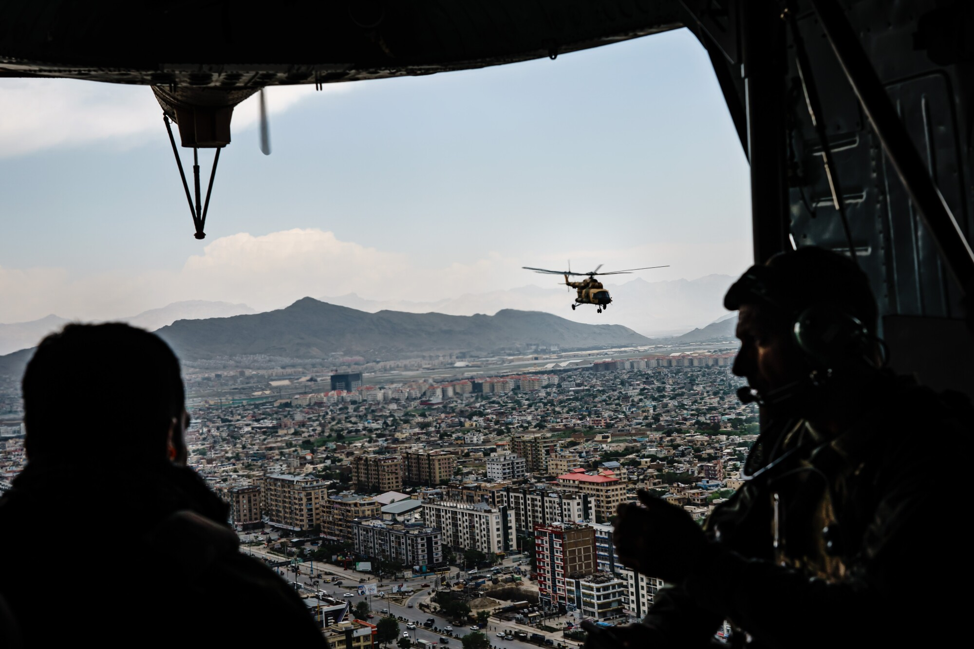 Helicopters fly over Kabul