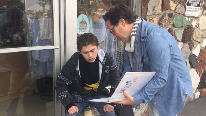 On the set at Shelter Island Cleaners in Point Loma, film director Marc Fusco discusses the script w