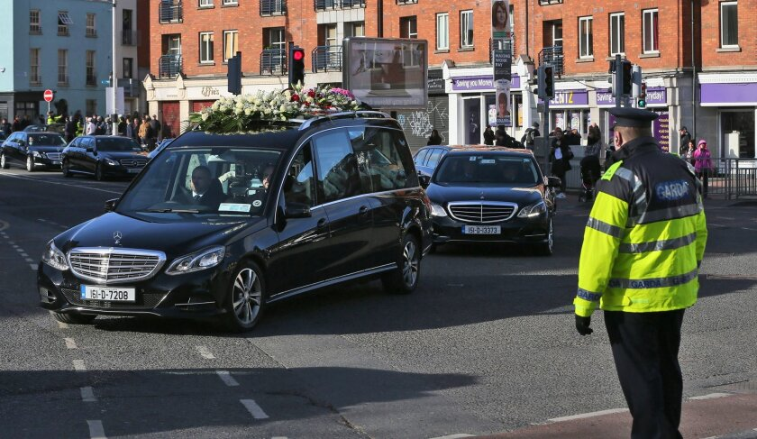 The funeral cortege processes through Dublin, Monday Feb. 15, 2016, during the funeral for David Byrne who was shot dead during a boxing weigh-in at the Regency Hotel in the north of the city on February 5.   Byrne was murdered by several gunmen armed with assault rifles, in what police believe was