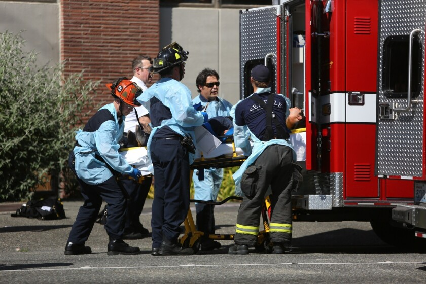 Firefighters remove a victim from the scene of a shooting at Seattle Pacific University on June 5.