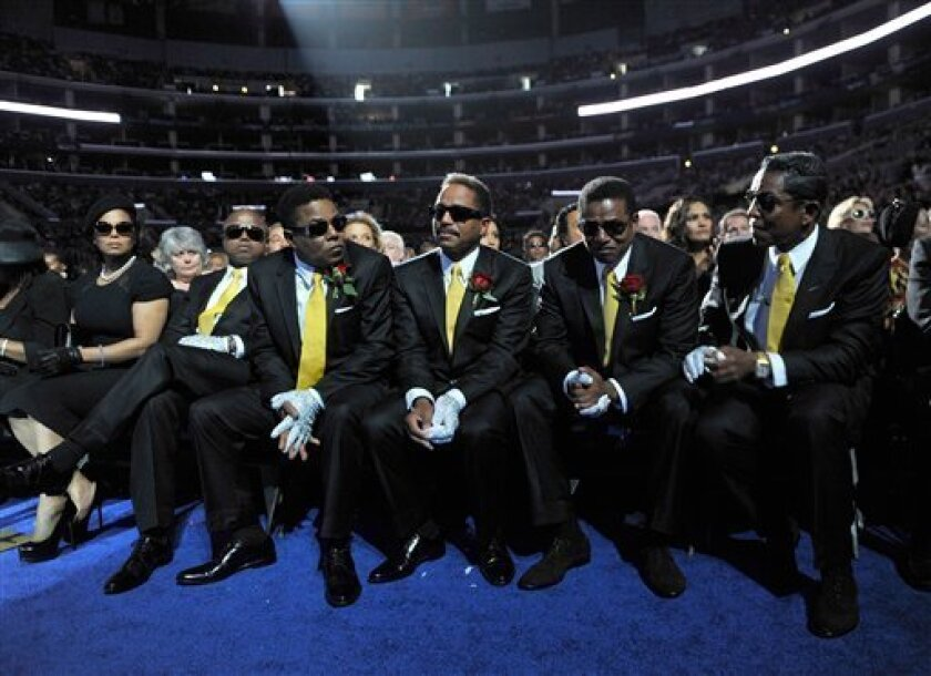 This photo provided by the MJ Memorial shows, from left to right, Rebbie Jackson, Janet Jackson, Randy Jackson, Tito Jackson, Marlon Jackson, Jackie Jackson and Jermaine Jackson at Michael Jackson's public memorial service held at Staples Center on Tuesday, July 7, 2009 in Los Angeles. (AP Photo/MJ Memorial, Kevin Mazur)