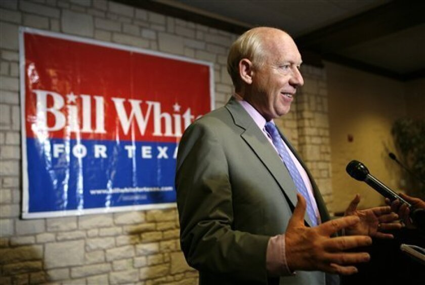 FILE - In this April 30, 2010 file photo, Texas Democratic gubernatorial candidate Bill White responds to a reporters question following a news conference in Grand Prairie, Texas. The former Houston mayor heads into the 2010 governor's race playing defense on a powerful political issue. The biggest liability for White is his past membership in a New York-based gun control group. White says he resigned after finding its positions too restrictive, but his participation in Mayors Against Illegal Guns riled up those who live to preserve Texas' pro-gun culture. (AP Photo/Tony Gutierrez, File)