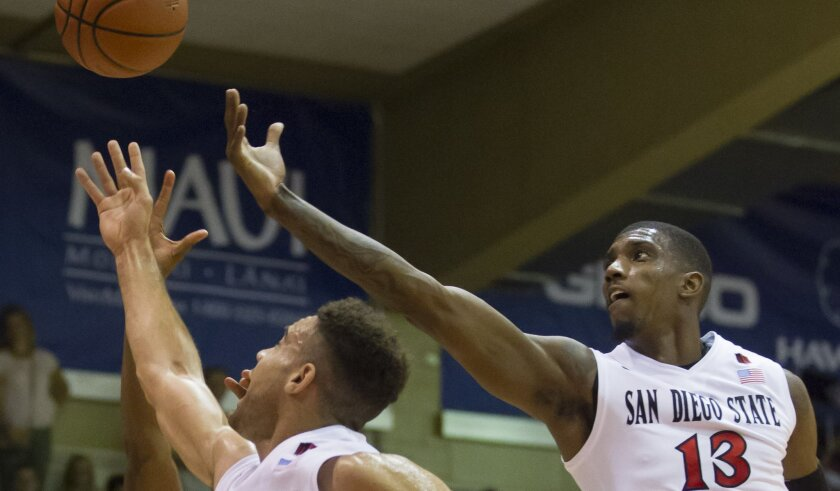 San Diego State's J.J. O'Brien (20) and Winston Shepard (13) go for a rebound against BYU on Monday, Nov. 24, 2014, at the Maui Invitational.