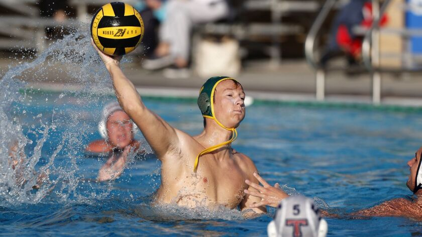 Edison High's Cameron Davidson scores against Tesoro during the second half in the first round of th
