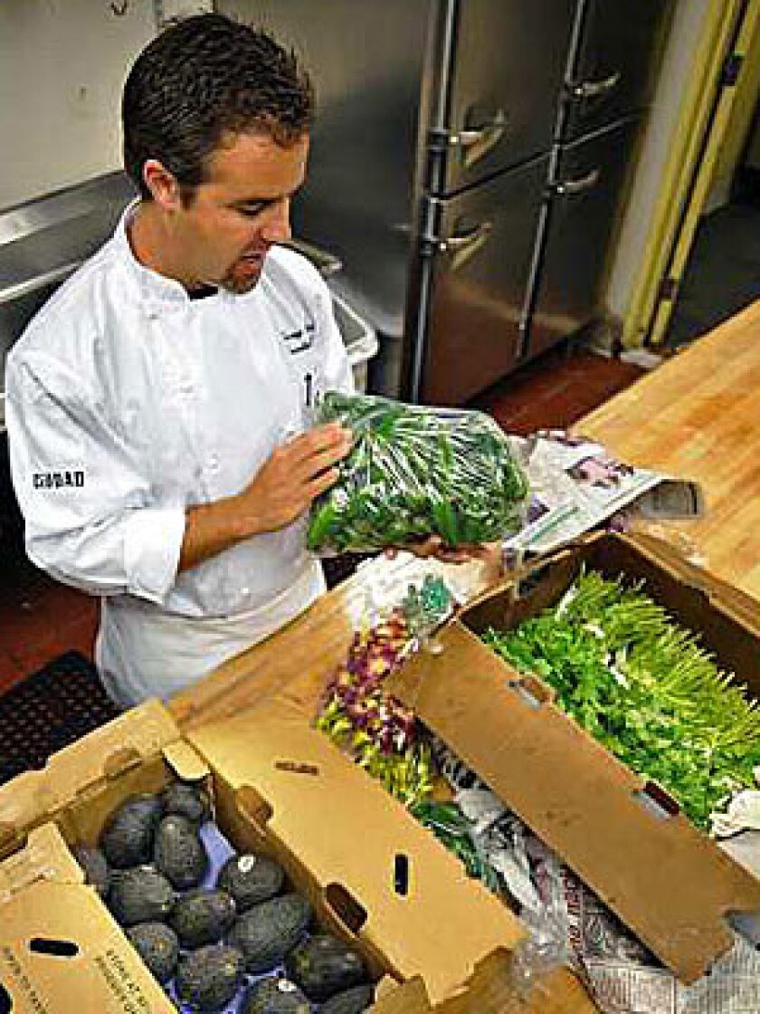 ON THE FRONT LINES: Executive chef Jeremy Tummel looks over produce that arrived this week at Ciudad restaurant in downtown Los Angeles.